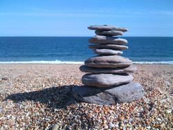 iPhone photo - stack of stone on pebble beach