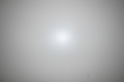 A white wall lit by a flash